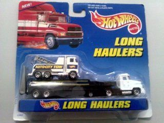Hot Wheels   Long Haulers Auto City Transport Rig (Tractor/Trailer) and Tow Truck Toys & Games
