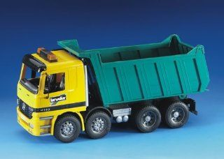 Mack Granite Dump Truck by Bruder Trucks: Toys & Games
