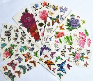 10pcs/package hot selling temporary tattoo stickers various designs including lotus/goldfish/colorful butterflies and flowers/butterfly angels/black flowers/etc: Toys & Games