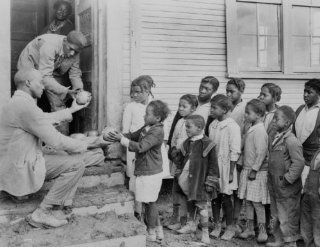 1930 photo Teacher distributing grapefruits to children outside church. Typic f1